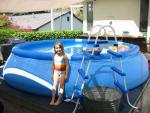 Lily stands in front of the new pool.