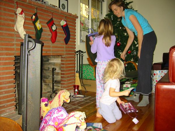 Lily shows mom what Santa brought